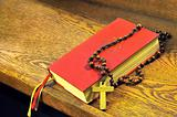 Hymnal  book and wooden rosary bead- detail