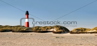 Panorama of a german lighthouse at the beach