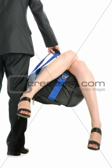 Man holds bag with sticking out female feet