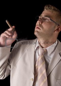 Businessman smoking cigar
