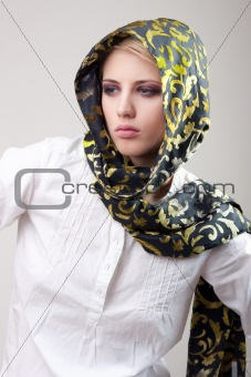 attractive blond girl in scarf and white shirt