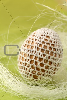 Easter egg with white crochet decoration