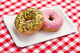 sweet doughnuts on paper plate