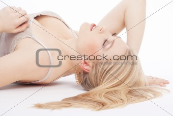 beautiful young woman lying down, eyes closed, dreaming - isolated on white