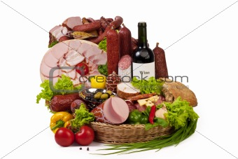 A composition of meat and vegetables with wine