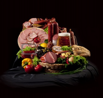 A composition of meat and vegetables with beer