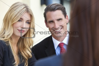 Attractive Businesswoman in Meeting with Colleagues