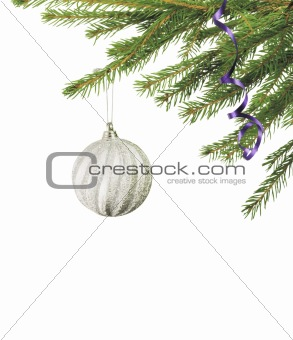 Christmas ball hanging with ribbons on fir tree