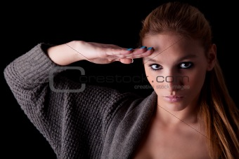 beautiful woman saluting isolated on black background. Studio shot