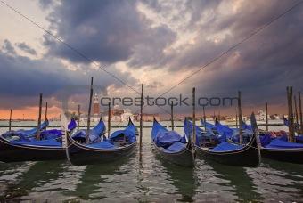 Gondolas bobbing in lagoon outside San Marco Piazza Venice Italy