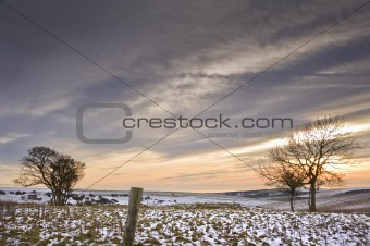 Beautiful colorful sunset over Winter landscape