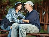 Middle-age couple sitting on a bench