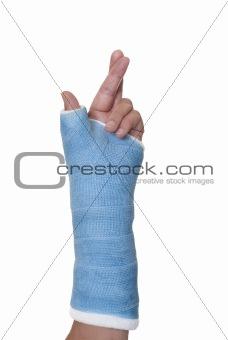 Broken arm in cast with fingers crossed