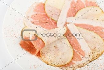 Sliced bacon with sliced pear