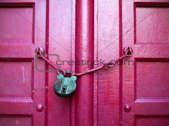 Green Key on Red Wood Door