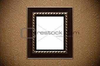 old style vintage golden ornament frame on textured wallpaper background
