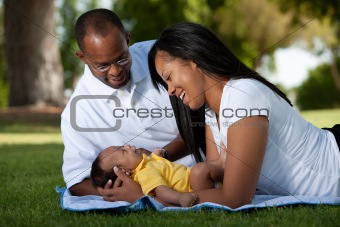 Loving couple with newborn at the park
