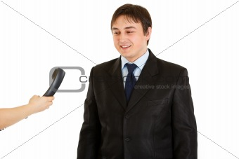 Smiling businessman looking at phone in hand of secretary