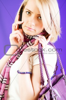 Blond girl talking on mobile phone