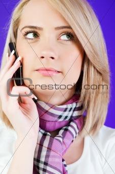 Blond girl talking on mobile phone