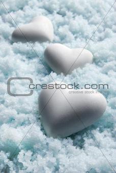 Blank white Hearts on Snow. Small DOF