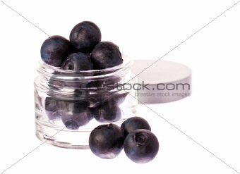 Fresh blueberries in a beauty cream jar
