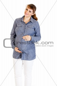 Smiling beautiful pregnant woman holding her belly isolated on white