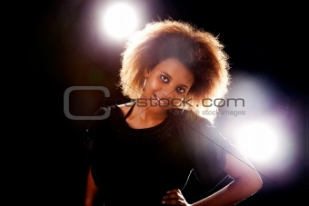 beautiful black  woman, smiling, isolated on black background