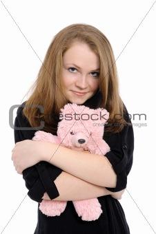beautiful girl  embraces teddy bear
