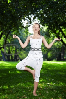 A girl in one of the yoga postures