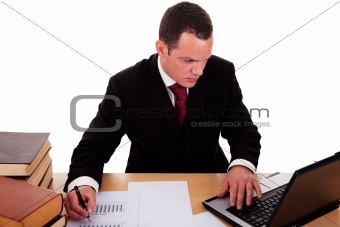 businessman  working and  looking to computer, isolated on white background. Studio shot.