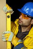 Worker checking vertical level