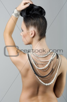 girl with necklace and hairstyle