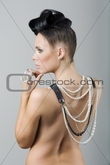 back side woman with hairstyle and jewelry