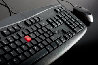 Close-up of black keyboard with mouse