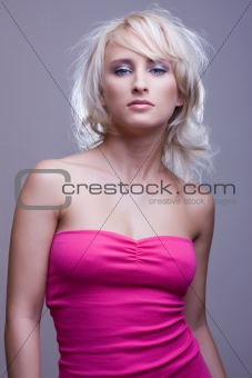 blonde girl in pink dress