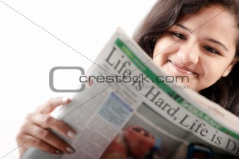 Smelling Indian teen reading newspaper