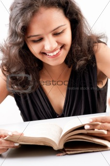 Indian girl enjoying reading book