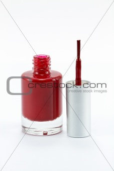 A bottle of red nail polish Isolated