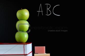 blackboard and apples