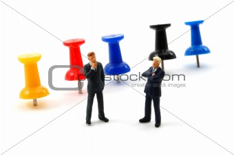 business man and push pin isolated on white
