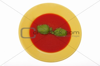 tomato soup in yellow plate