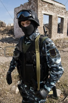 Portrait of an armed soldier outdoors