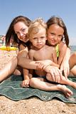Young mom with kids at the beach resort