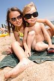 Two young kids having fun at the beach