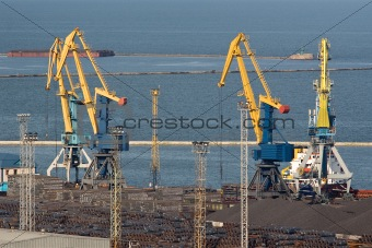 Four huge industrial cranes at the commercial dock