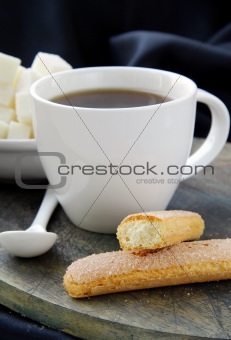 A cup of black coffee and refined sugar