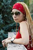 Rapper girl in red posing outdoors