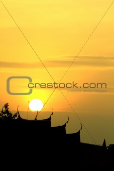 Black silhouette on sunset background