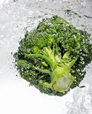 Green broccoli dropped into water